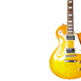 Lemon sunburst classic electric guitar on the right side of white background, with plenty of copy space. Royalty Free Stock Photography