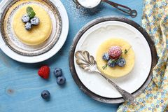 Lemon Surprise Pudding cake  served with berries Stock Image