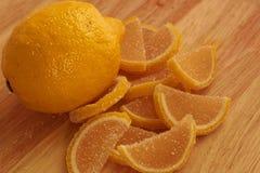 Lemon and sweet lemon jelly slices. One lemon and sweet lemon jelly slices royalty free stock image