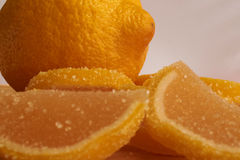 Lemon and sweet lemon jelly slices. One lemon and sweet lemon jelly slices Stock Photos