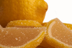 Lemon and sweet lemon jelly slices. One lemon and sweet lemon jelly slices Stock Photography