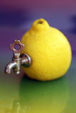 Lemon with tap creative Stock Images