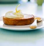 Lemon tart. Small lemon tart with a golden spoon Stock Images