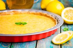 Lemon tart in baking dish Stock Photo