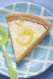 Lemon tart. On blue late royalty free stock photography