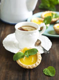 Lemon Tart and cup of tea Stock Images