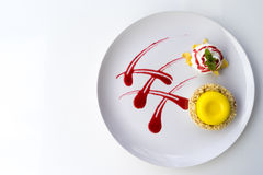 Lemon Tart. Garnished with strawberry sauce. On a white table. Free space for text . Top view Stock Image