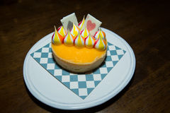 Lemon tart, Lemon, Tart, colorful White Chocolate stripes. On Tarot tart. Beautiful pattern on a plate Stock Photo