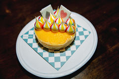 Lemon tart, Lemon, Tart, colorful White Chocolate stripes. On Tarot tart. Beautiful pattern on a plate Stock Image