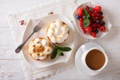 Lemon tart with meringue and berry mix, coffee  close-up. horizo Royalty Free Stock Image