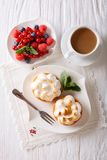 Lemon tart with meringue and berry mix, coffee  close-up. vertic Royalty Free Stock Photos
