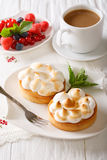 Lemon tart with meringue and coffee with milk close-up. vertical Stock Images