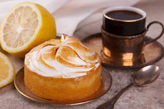 Lemon tart pie with cup of coffee Stock Images