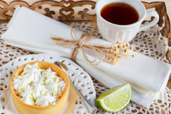 Lemon tart pie on  plate with tea cup  Royalty Free Stock Image