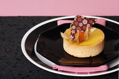 Lemon tart on pink and black Royalty Free Stock Photos