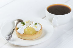 Lemon tart on the plate with coffee Stock Photos
