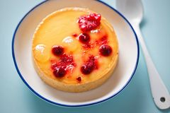 Lemon tart with red fruits Royalty Free Stock Images