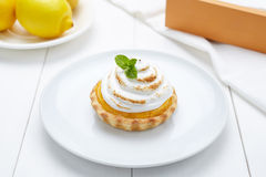 Lemon tart with whipped cream and mint sweet dessert Royalty Free Stock Photos