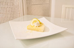 Lemon tart on white dish Stock Photography