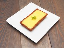 Lemon tart on a plate. Lemon tart on white plate Stock Photos