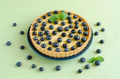 Lemon tartlet decorated with blueberries and mint Stock Image