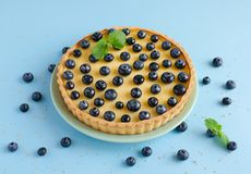 Lemon tartlet decorated with blueberries and mint Royalty Free Stock Image