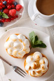 Lemon tartlet with meringue and summer berries close-up. vertica Royalty Free Stock Photos