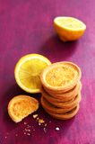 Lemon tartlets on deep pink background. Pile of lemon tartlets with copy space on deep pink background stock photo