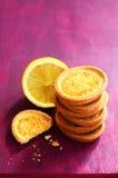Lemon tartlets on deep pink background. Pile of lemon tartlets on with copy space on deep pink background stock photos