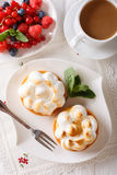 Lemon tartlets with meringue, berries and coffee close-up. verti Stock Images