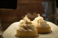 Lemon tartlets on a white plate stock images