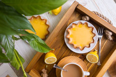 Lemon tarts and coffee Stock Images