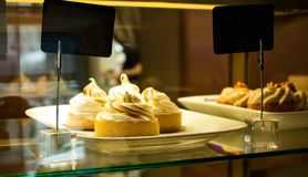 Lemon tarts in the window of the cafe royalty free stock photo