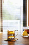 Lemon tea. A cup of black tea with lemon on a table, side view Stock Photography