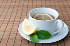 Lemon tea. Cup of freshly brewed hot lemon tea with sliced lemon Royalty Free Stock Photography