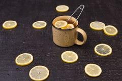 Lemon tea on a black background Stock Photos