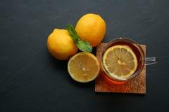 Lemon tea on black background. Lemon tea with mint leaf on black background Royalty Free Stock Photos