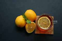 Lemon tea on black background. Lemon tea with mint leaf on black background Stock Images
