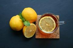 Lemon tea. On black blackground Royalty Free Stock Photos