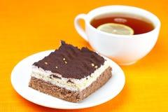 Lemon tea and cake Stock Images
