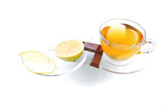 Lemon and tea with chocolate. On transparent dishware Royalty Free Stock Photography