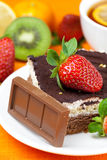 Lemon tea,chocolate, kiwi,cake and strawberries Royalty Free Stock Photos
