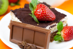 Lemon tea,chocolate, kiwi,cake and strawberries Stock Photography
