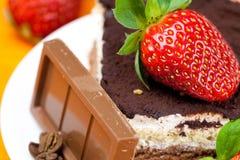 Lemon tea,chocolate, kiwi,cake and strawberries Royalty Free Stock Photography