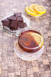 Sweet evening tea. Lemon tea with chocolates on a table Royalty Free Stock Photos