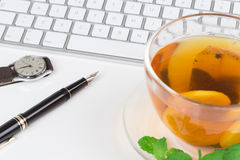Lemon Tea with computer keyboard Royalty Free Stock Photos