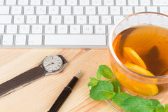 Lemon Tea with computer keyboard Royalty Free Stock Photo