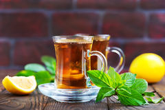 Lemon tea. In cup and on a table Stock Image