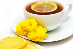 Lemon tea with flowers Stock Photos
