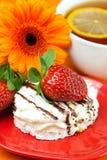 Lemon tea,gerbera,cake and strawberries Royalty Free Stock Photography